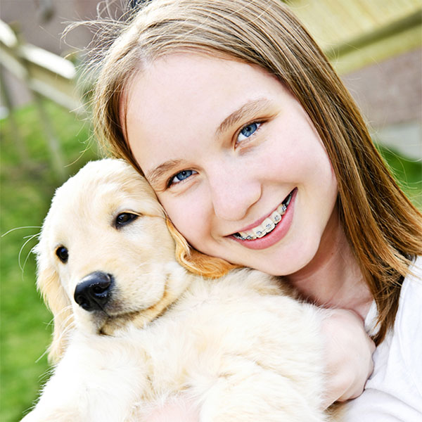 Girl with braces and dog